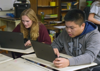 Two students work on portable computers similar to those that would be purchased as part of proposed technology and safety levy measure
