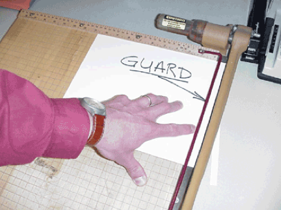 Paper cutting with guard on tabletop