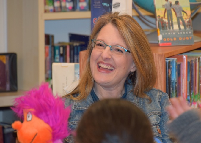 Madison Elementary reading specialist Lisa Escourt has surprised look on her face at OSD Teacher of the Year announcement