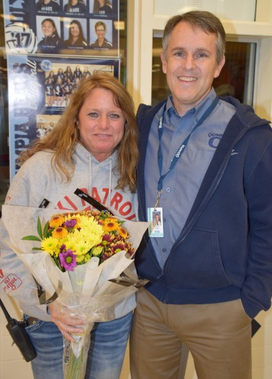 Regional Classified School Employee of the Year Carolyn Poage poses with Olympia HIgh Principal Matt Grant after she was surprised last fall at being named an OSD Classified School Employee of the Year
