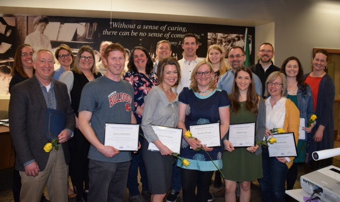 New NBCT and those who have renewed certification pose as a group with the school board at the March 12 board meeting.