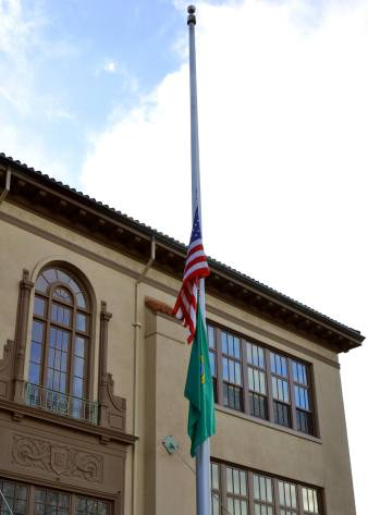 Flags at half mast outside the Knox Administrative Building in Olympia