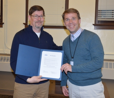 Superintendent Patrick Murphy and OEA President Adam Brickell pose with copy of Teacher Appreciation Week proclamation