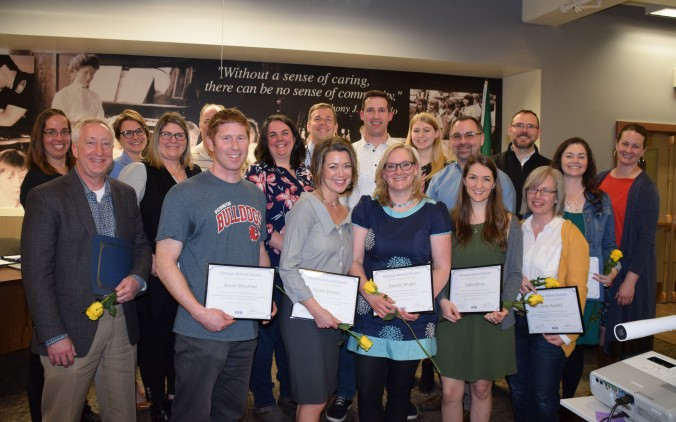 New National Board Certified Teachers pose for a photo holding their framed certificates at the March 12 Olympia School Board meeting.