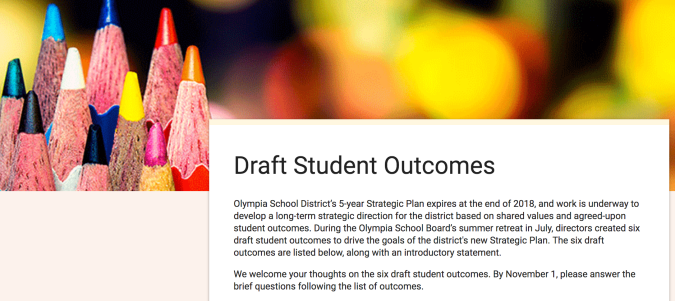 Opening paragraphs of the introduction on an online feedback from about Draft Student Outcomes, accompanied by sharpened colored pencils to encourage filling out the form