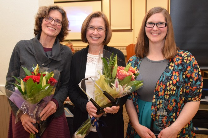 Three OSD Teachers of the Year pose after being honored by school board