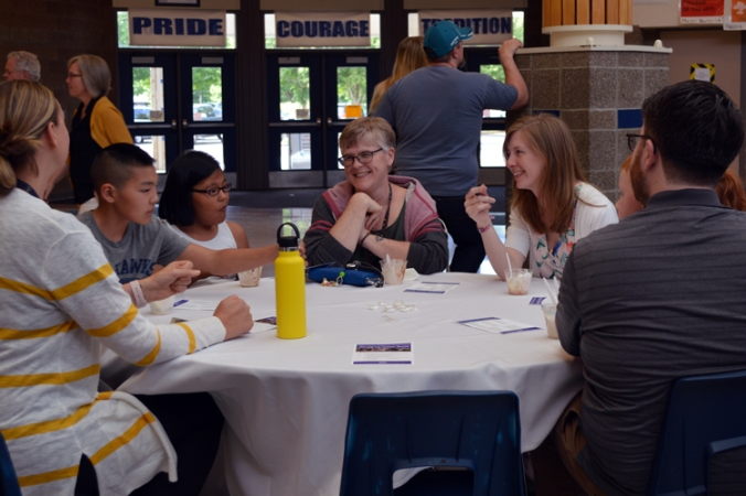Guests gathered at a table at the 2018 OSD Ice Cream Social