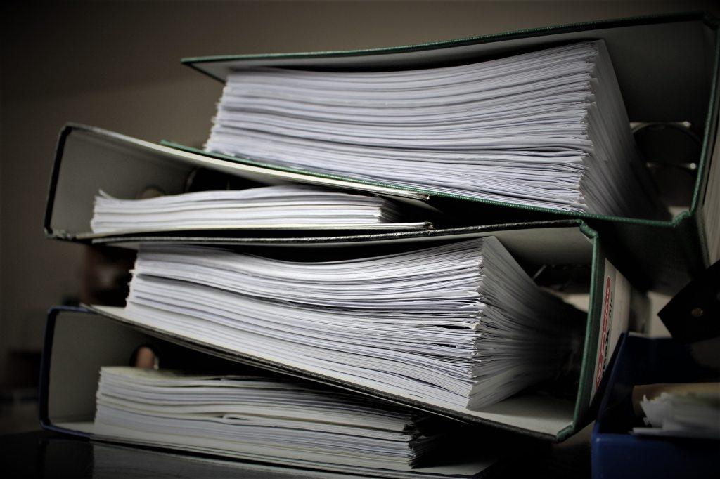 Stack of binders full of paperwork
