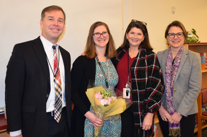 OSD Elementary Teacher of the Year in 2019 Devin Alexander joined by the superintendent Patrick Murphy, LP Brown Principal Charlene Hayes, and Board Member Joellen Wilhelm