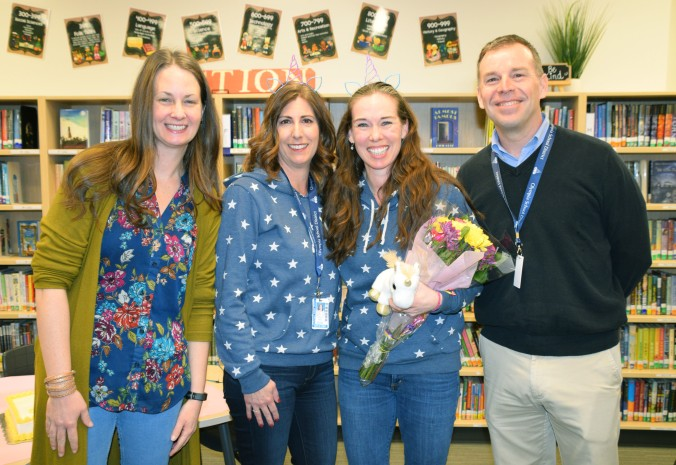 OSD Teacher of the Year Elaine Rinker poses with CES Principal Shannon Ritter, Superintendent Patrick Murphy and OSD Board President Hilary Seidel