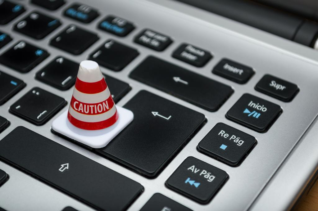 Caution cone sits on computer keyboard