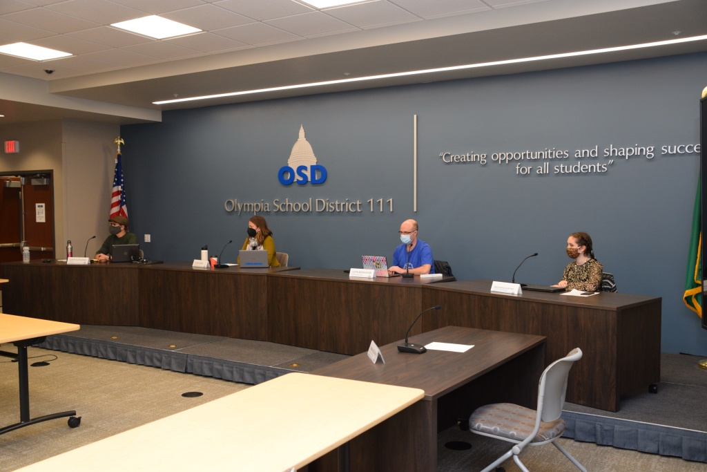 Board members, wearing face coverings, pictured during a recent in-person board meeting in the Knox 111 Board Room.