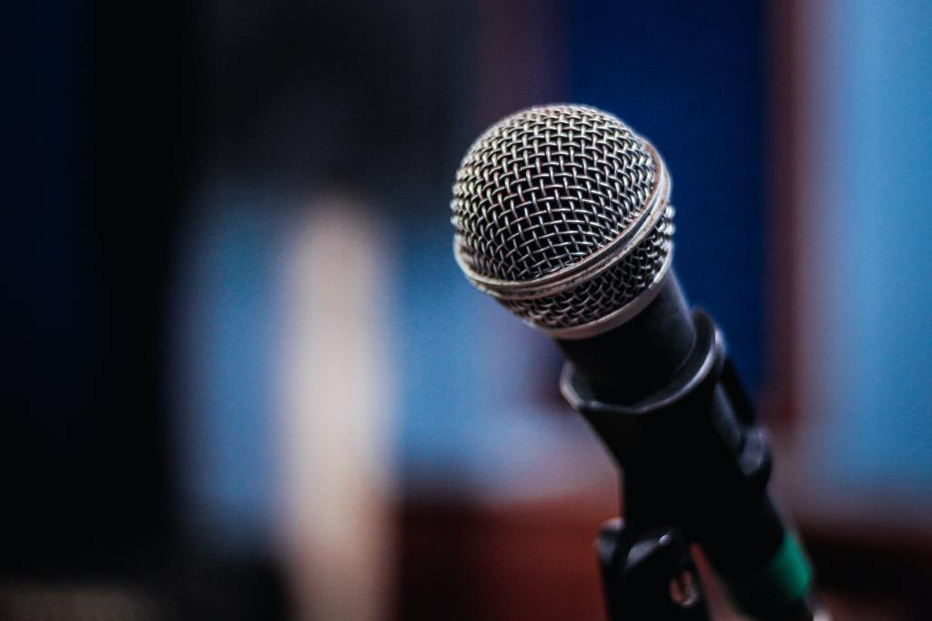 Black microphone with blue lighting in the background