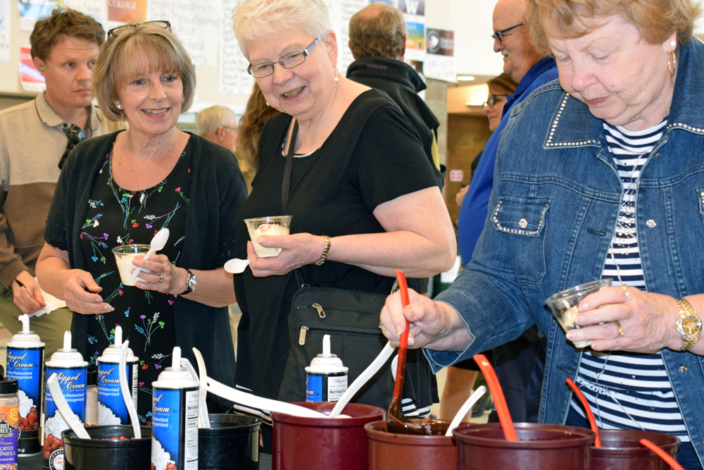 OSD retires fill ice-cream cups with toppings during a prior year's ice cream social