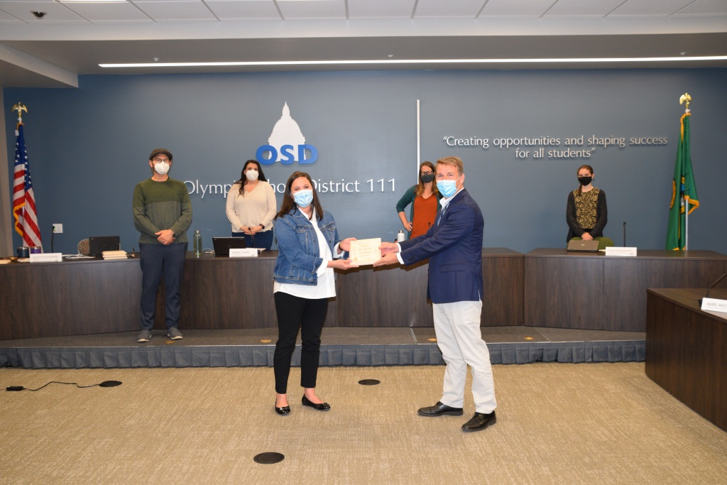 Superintendent Murphy presents award plaque to Melissa Wood.