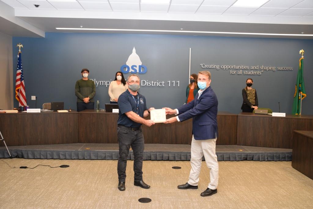 Superintendent Murphy presents plaque to Paul Rae